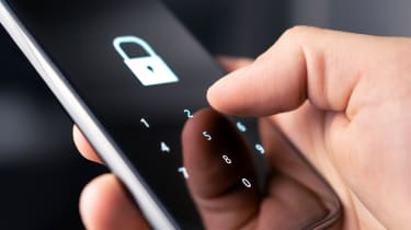 A padlock and a number pad displayed on a smartphone display