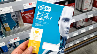 A hand holding a Eset Smart Security Package