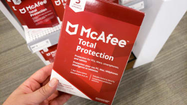 Hand holding a McAfee Total Protection package