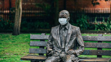 Alan Turing memorial statue, located in Sackville Park, Manchester, wearing a face mask