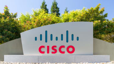 A Cisco sign at the company's HQ with trees in the background