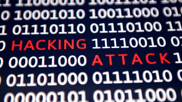 binary on a screen with words 'hacking attack'