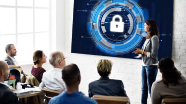 An employee delivers a presentation on cyber security to her colleagues