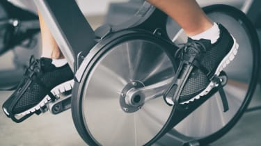 Peloton bike's wheels with a person's feet on the pedals
