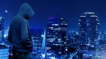 Hacker overlooking a city