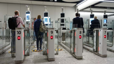 Air travellers pass through automated passport border control gates at Heathrow Airport, where the UK Border Force uses facial recognition technology.