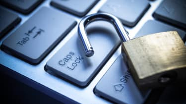 An opened padlock on a laptop keyboard