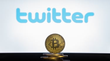 The Twitter logo in the background of a a coin representing the physical embodiment of Bitcoin
