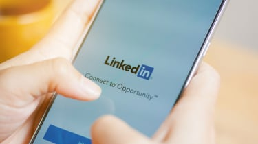 A user accessing LinkedIn on their mobile phone device