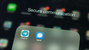 The logos for the Telegram and Signal mobile apps on an iPhone, shown to depict secure messaging services