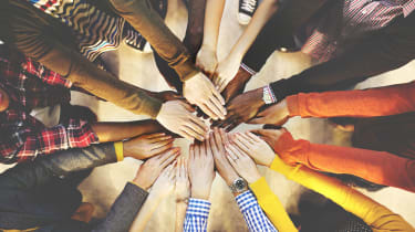 People joining hands as a symbol of teamwork